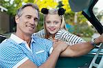 Smiling father and daughter in convertible Stock Photo - Premium Royalty-Free, Artist: CulturaRM, Code: 635-05971797