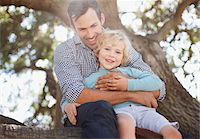 Father and son relaxing outdoors Stock Photo - Premium Royalty-Freenull, Code: 635-05971805
