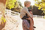 Father carrying son on his shoulders Stock Photo - Premium Royalty-Free, Artist: Aflo Sport, Code: 635-05971808