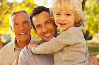 Three generations of men smiling together Stock Photo - Premium Royalty-Freenull, Code: 635-05971815