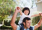 Father carrying son on shoulders outdoors Stock Photo - Premium Royalty-Freenull, Code: 635-05971816