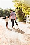 Father and son walking on dirt road Stock Photo - Premium Royalty-Freenull, Code: 635-05971818