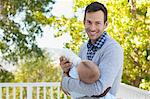 Father bottle feeding son outdoors Stock Photo - Premium Royalty-Free, Artist: Blend Images, Code: 635-05971819