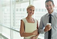 Smiling business people standing in office Stock Photo - Premium Royalty-Freenull, Code: 635-05971901
