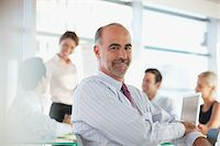 Businessman sitting in meeting Stock Photo - Premium Royalty-Freenull, Code: 635-05971917