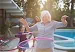 Older woman hula hooping in backyard Stock Photo - Premium Royalty-Freenull, Code: 635-05971962