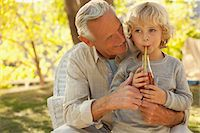 sucking - Older man and grandson relaxing outdoors Stock Photo - Premium Royalty-Freenull, Code: 635-05971965