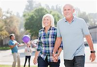 Older couple walking together outdoors Stock Photo - Premium Royalty-Freenull, Code: 635-05971982
