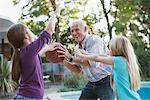 Older man playing basketball with granddaughters Stock Photo - Premium Royalty-Free, Artist: Blend Images, Code: 635-05971991