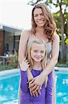 Mother and daughter standing by pool Stock Photo - Premium Royalty-Freenull, Code: 635-05971998