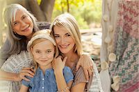 Three generations of women smiling together Stock Photo - Premium Royalty-Freenull, Code: 635-05972000