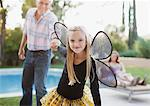 Girl in fairy wings pulling grandfather along Stock Photo - Premium Royalty-Free, Artist: Blend Images, Code: 635-05972004