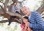 Older man hugging granddaughter outdoors Stock Photo - Premium Royalty-Freenull, Code: 635-05972008