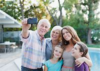 Family taking picture of themselves outdoors Stock Photo - Premium Royalty-Freenull, Code: 635-05972025