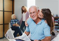Girl kissing grandfather in home Stock Photo - Premium Royalty-Freenull, Code: 635-05972031