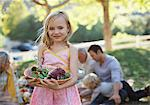 Girl carrying bowl of salad outdoors Stock Photo - Premium Royalty-Free, Artist: Blend Images, Code: 635-05972041