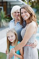 Three generations of women smiling together Stock Photo - Premium Royalty-Freenull, Code: 635-05972042