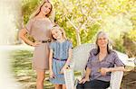 Three generations of women smiling together Stock Photo - Premium Royalty-Freenull, Code: 635-05972043