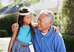 Older man and granddaughter standing outdoors Stock Photo - Premium Royalty-Free, Artist: Blend Images, Code: 635-05972046