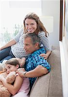 Family relaxing on sofa together Stock Photo - Premium Royalty-Freenull, Code: 635-05972061