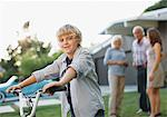 Boy riding bicycle outdoors Stock Photo - Premium Royalty-Freenull, Code: 635-05972062