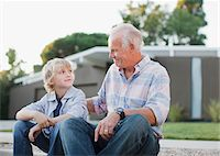 preteens pictures older men - Older man and grandson sitting together Stock Photo - Premium Royalty-Freenull, Code: 635-05972068