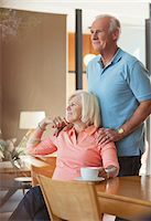 Older couple relaxing together in kitchen Stock Photo - Premium Royalty-Freenull, Code: 635-05972093