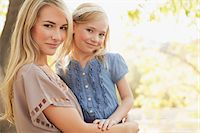 Mother holding daughter outdoors Stock Photo - Premium Royalty-Freenull, Code: 635-05972110
