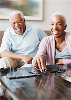 Laughing older couple playing dominoes Stock Photo - Premium Royalty-Freenull, Code: 635-05972111