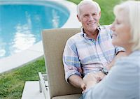 Smiling older couple relaxing outdoors Stock Photo - Premium Royalty-Freenull, Code: 635-05972113