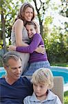 Family relaxing together outdoors Stock Photo - Premium Royalty-Free, Artist: Blend Images, Code: 635-05972133