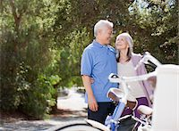 Smiling older couple hugging outdoors Stock Photo - Premium Royalty-Freenull, Code: 635-05972137