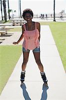 roller skate - Smiling woman skating in park Stock Photo - Premium Royalty-Freenull, Code: 635-05972187