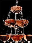Champagne pouring into stacked glasses Stock Photo - Premium Royalty-Free, Artist: Blend Images, Code: 635-05972246
