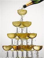 Champagne pouring into stacked glasses Stock Photo - Premium Royalty-Freenull, Code: 635-05972249