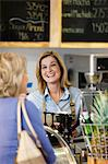 Server in supermarket talking with customer Stock Photo - Premium Royalty-Free, Artist: Blend Images, Code: 635-05972312