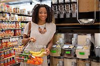 Woman shopping in supermarket Stock Photo - Premium Royalty-Freenull, Code: 635-05972326