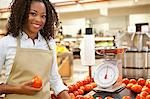 Worker weighing produce in supermarket Stock Photo - Premium Royalty-Free, Artist: AWL Images, Code: 635-05972342