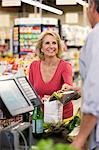 Woman buying groceries at supermarket Stock Photo - Premium Royalty-Free, Artist: Blend Images, Code: 635-05972345