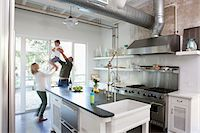 stove - Family playing together in kitchen Stock Photo - Premium Royalty-Freenull, Code: 635-05972346
