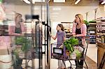 Mother and daughter shopping in supermarket Stock Photo - Premium Royalty-Freenull, Code: 635-05972348