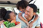 Family unloading groceries from car Stock Photo - Premium Royalty-Free, Artist: Ikon Images, Code: 635-05972352
