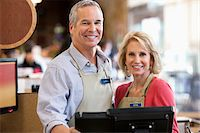 Workers using cash register in supermarket Stock Photo - Premium Royalty-Freenull, Code: 635-05972358