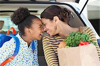 Mother and daughter unloading groceries from car Stock Photo - Premium Royalty-Freenull, Code: 635-05972364