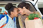 Mother and daughter unloading groceries from car Stock Photo - Premium Royalty-Free, Artist: AlaskaStock, Code: 635-05972364