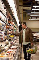 Man shopping in supermarket Stock Photo - Premium Royalty-Freenull, Code: 635-05972377