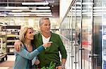 Older couple shopping in supermarket Stock Photo - Premium Royalty-Free, Artist: ableimages, Code: 635-05972381