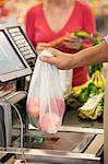 Cashier ringing up groceries in supermarket Stock Photo - Premium Royalty-Free, Artist: Michael Mahovlich, Code: 635-05972382