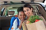 Mother and daughter unloading groceries from car Stock Photo - Premium Royalty-Free, Artist: Minden Pictures, Code: 635-05972387