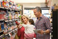Family shopping for juice in supermarket Stock Photo - Premium Royalty-Freenull, Code: 635-05972390